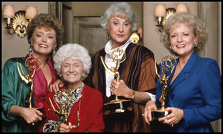 Photo of the cast of the Golden Girls, smiling and holding awards