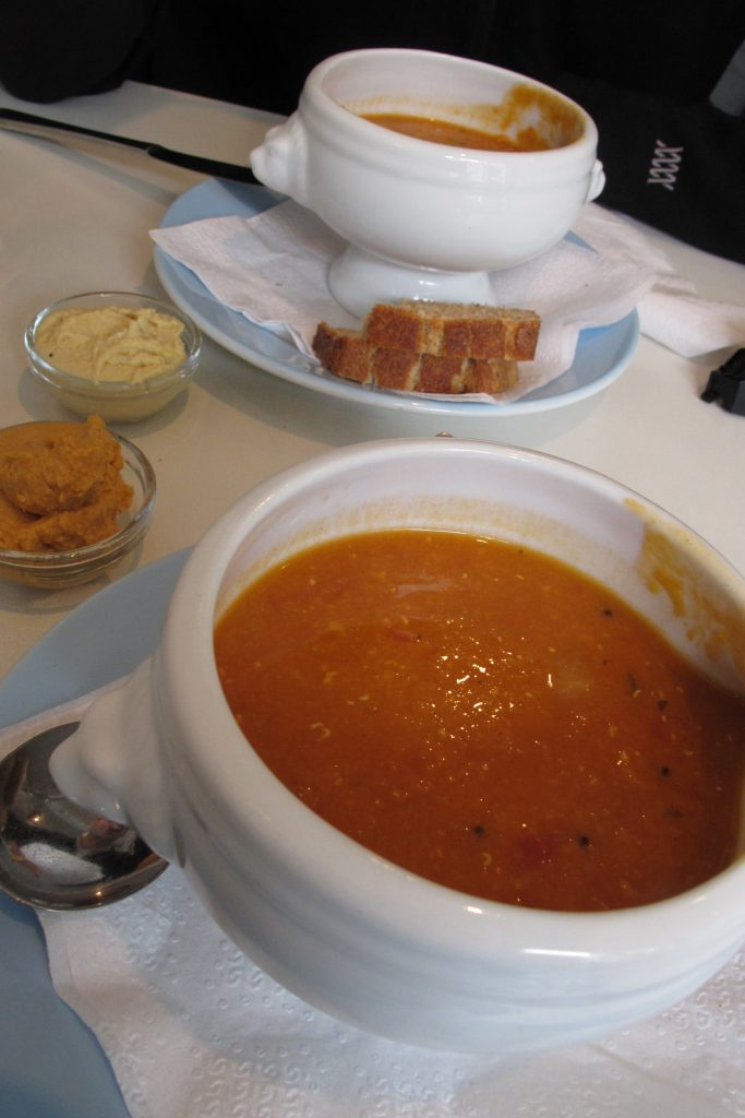 Soup in white bowl from an upward angle