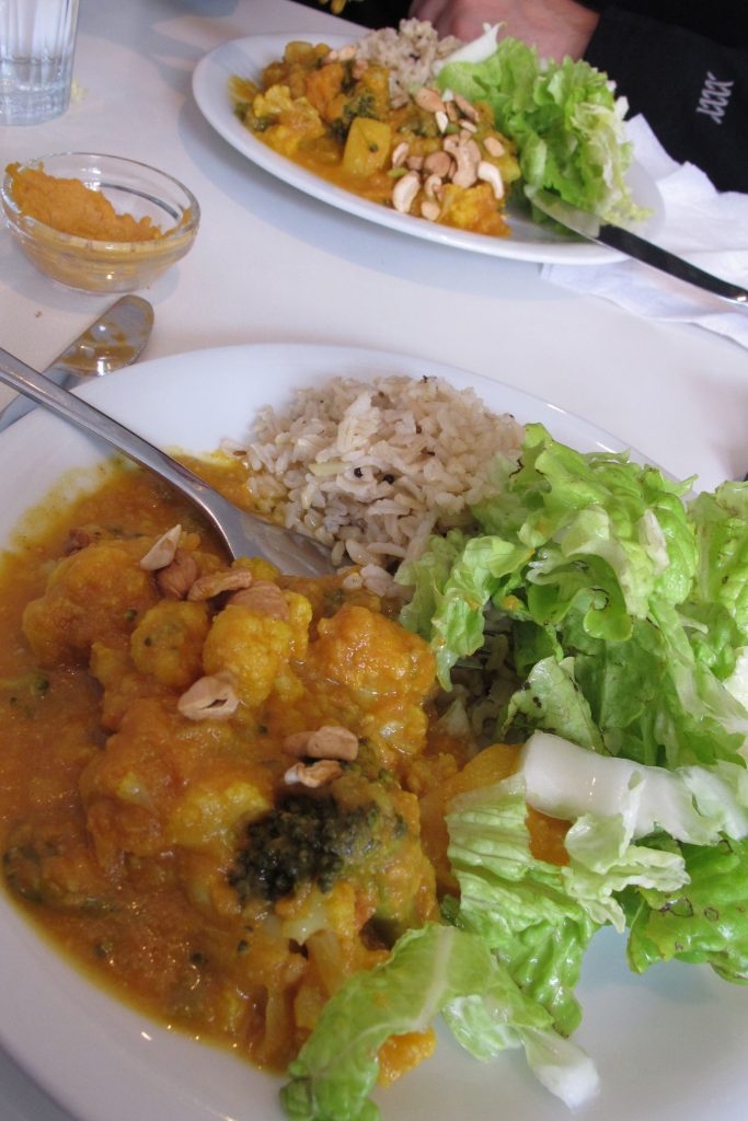 Curry, salad and rice viewed from an upward angle