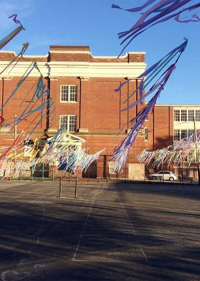 07-30-17: Streamers hanging in the wind outside a building